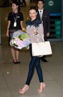 Miranda Kerr holding a bouquet