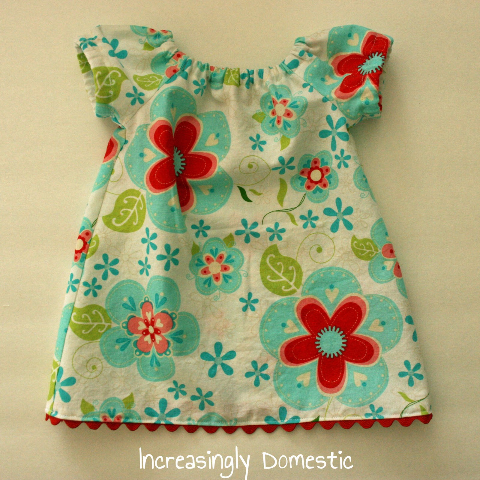 Abby from sew much ado shared this free infant peasant dress pattern