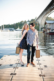 Emily and Kent have suitcases in had standing on Lake Union dock