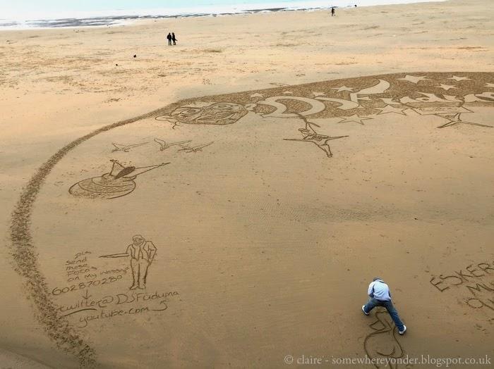 'sand artist' in San Sebastian, Spain