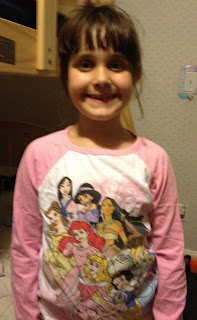 Girl wearing Disney princess long sleeved t-shirt