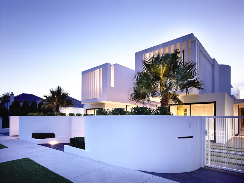 Facade of Perfect Modern Townhouse by Martin Friedrich Architects at night