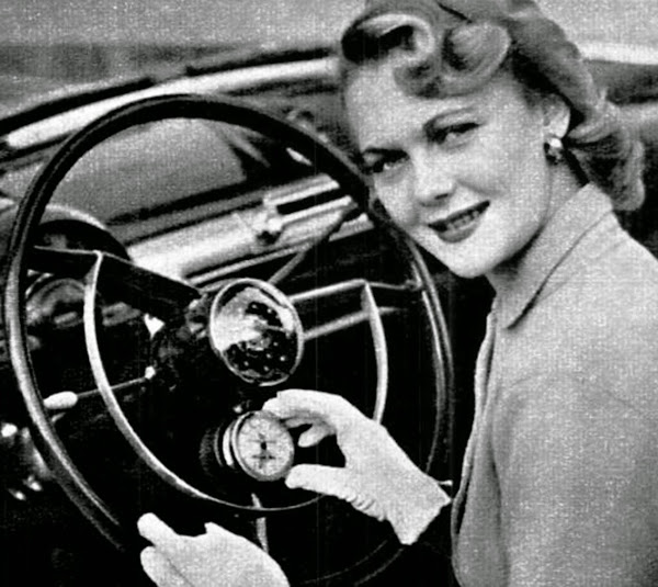 1951 Lady driving a Ford