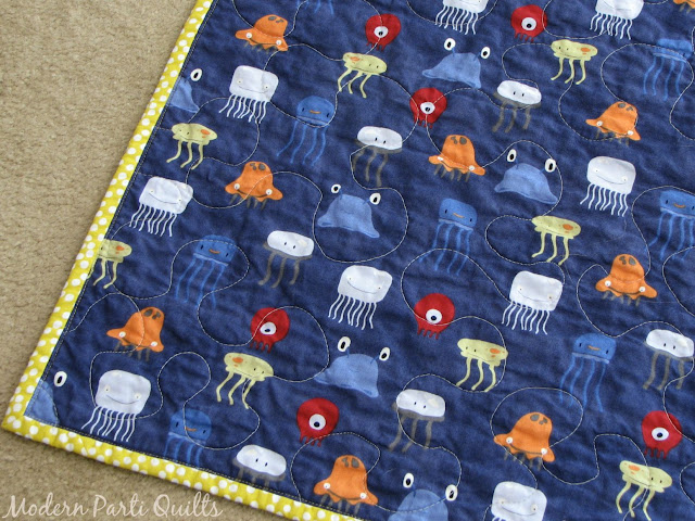 Modern parti quilts sea monster baby quilt for Space baby fabric