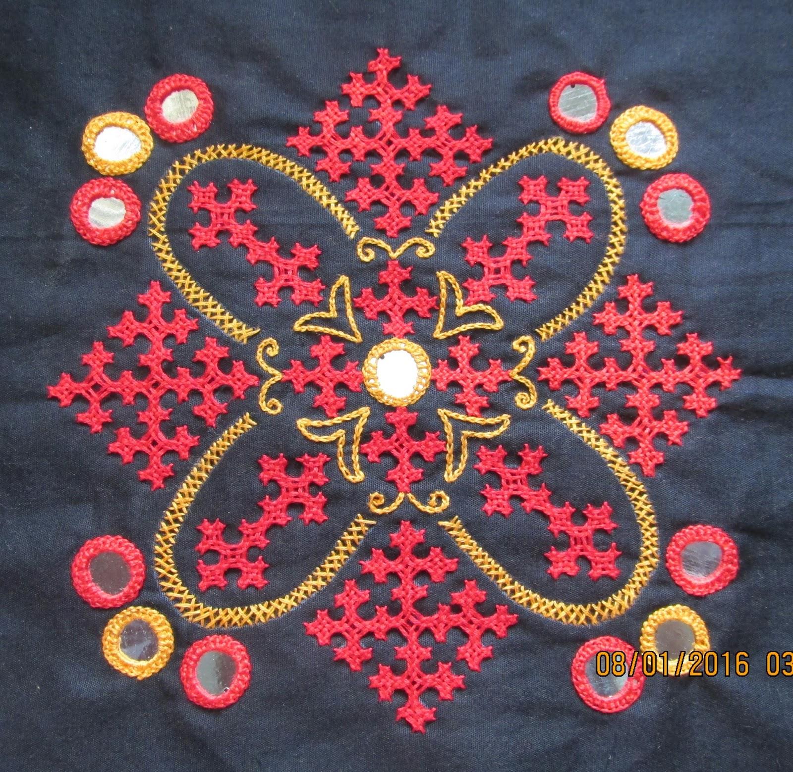 My craft works kutch work motif and a cross stitch ta da