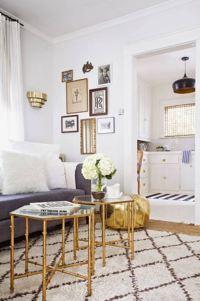 white room with gold accessories coffee table