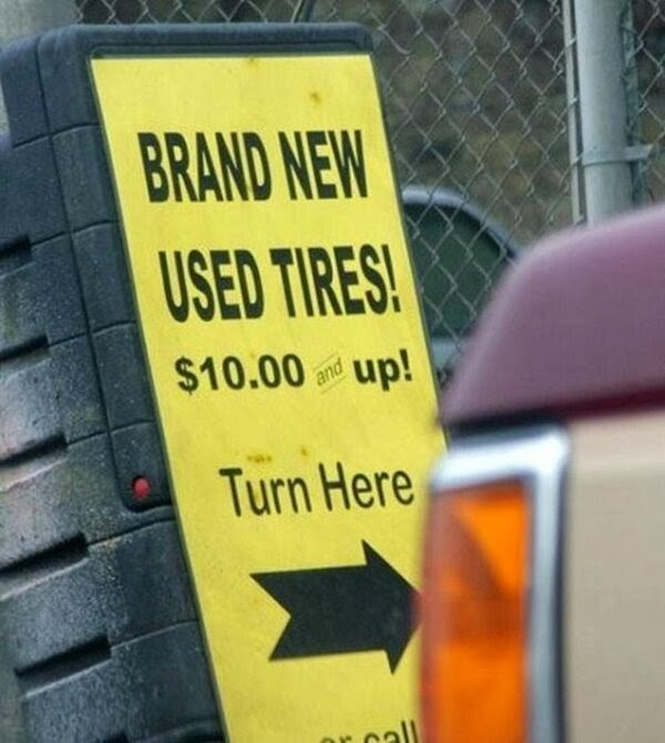 brand new used tires sign