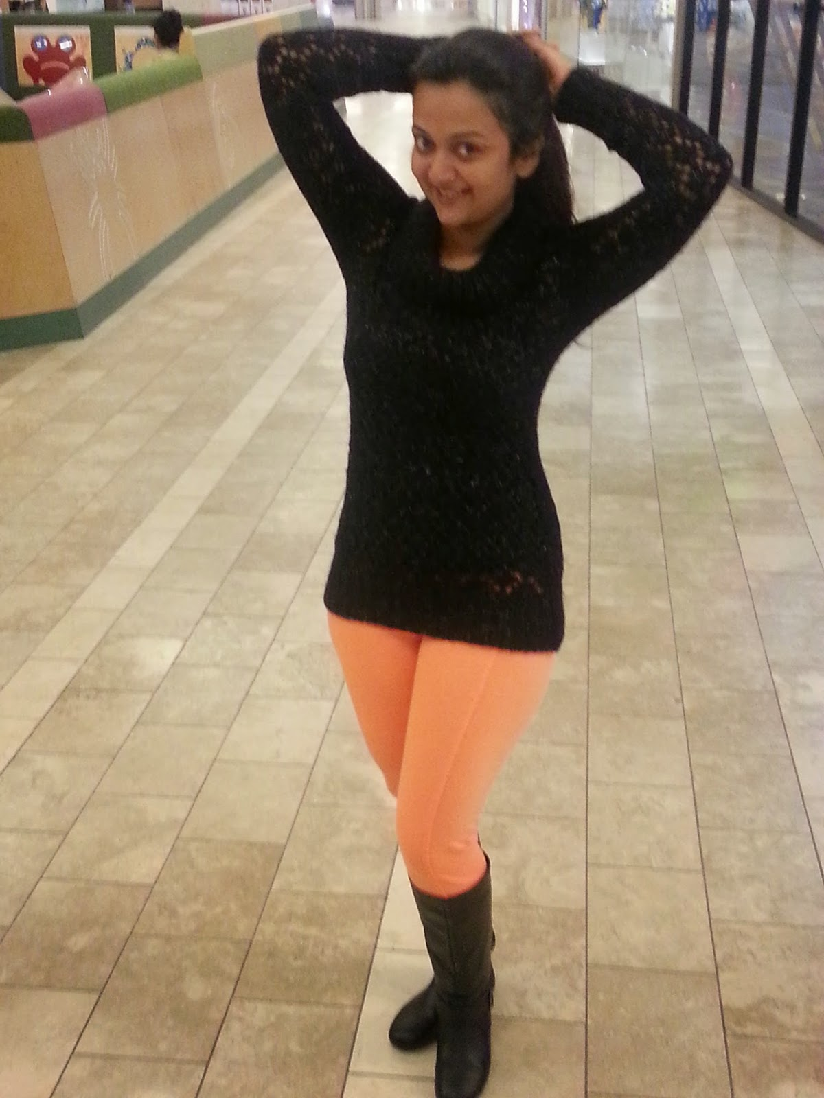 Orange pants with black knitted top, Orange leggings, Orange tights, colored pants, Seattle Fashion Blogger, Ananya without make up