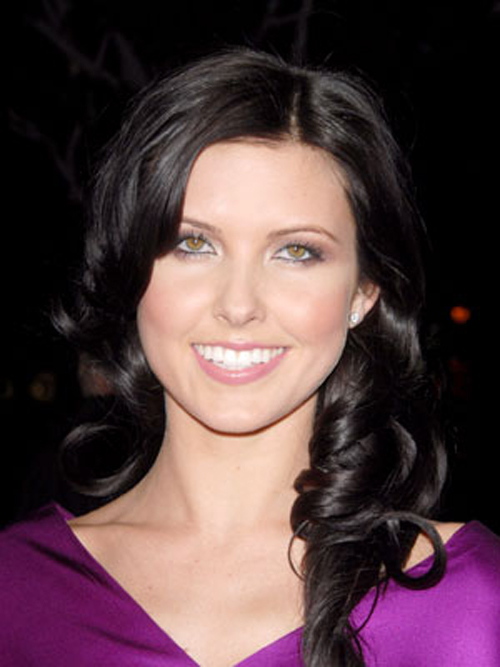 Rolled-forward curls hairstyles draw attention to Audrina Patridge's beautiful facial features.