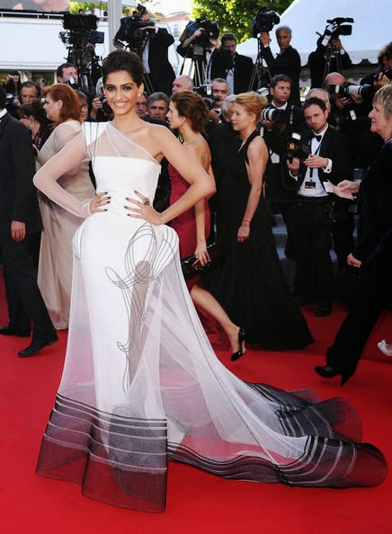 "The gorgeous Bollywood Actress Sonam Kapoor looked edgy, elegant and chic in a sheer Jean Paul Gaultier Couture one-shoulder gown at the ""The Artist"" premiere held at the Palais des Festivals during the 64th Annual Cannes Film Festival on May 15, 2011 in Cannes, France."