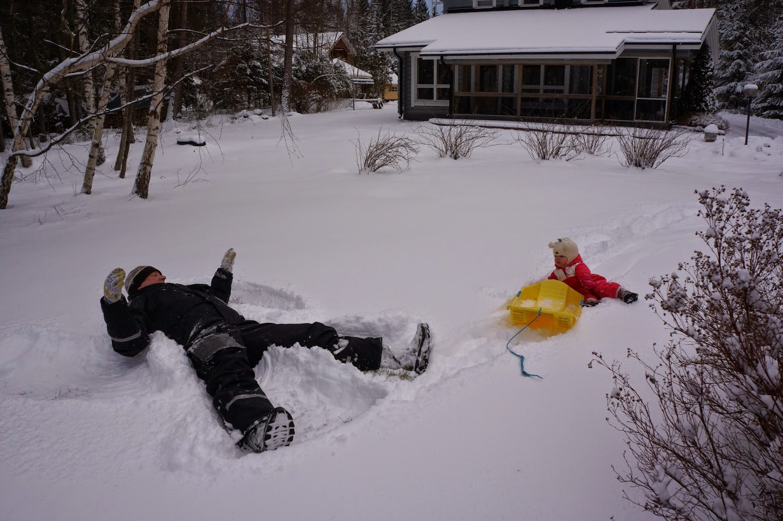making snowangels toddler