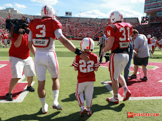 Jack Hoffman takes the field with the Nebraska football team