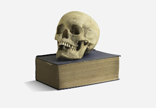 Human Skull on top of a Book.
