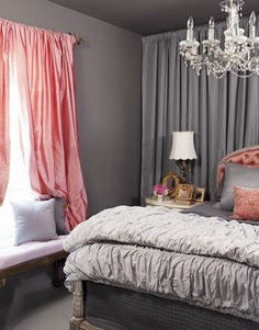 grey bedroom with silver bedding and pink curtains