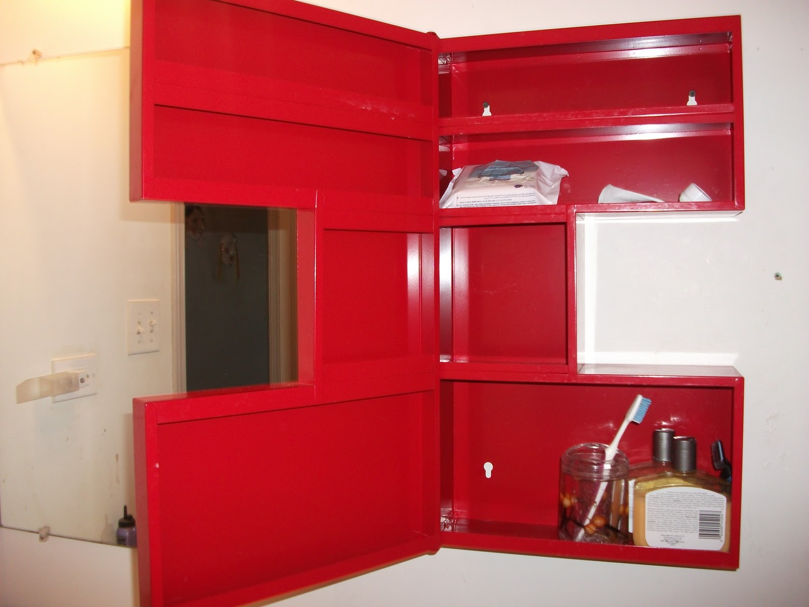 This Is A Beautiful Red Medicine Cabinet From IKEA. Bought In Novermber,  2009. Interesting Shape. Features: Has Compartments Inside To Hold Items.