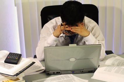 Man tired at his desk