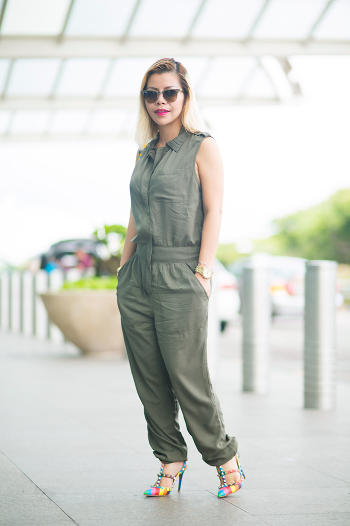 Fashion Blogger Crystal Phuong spotted at the airport in Forever21 olive jumpsuit and Valentino heels