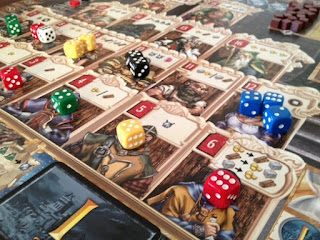 dice on board while playing Kingsburg