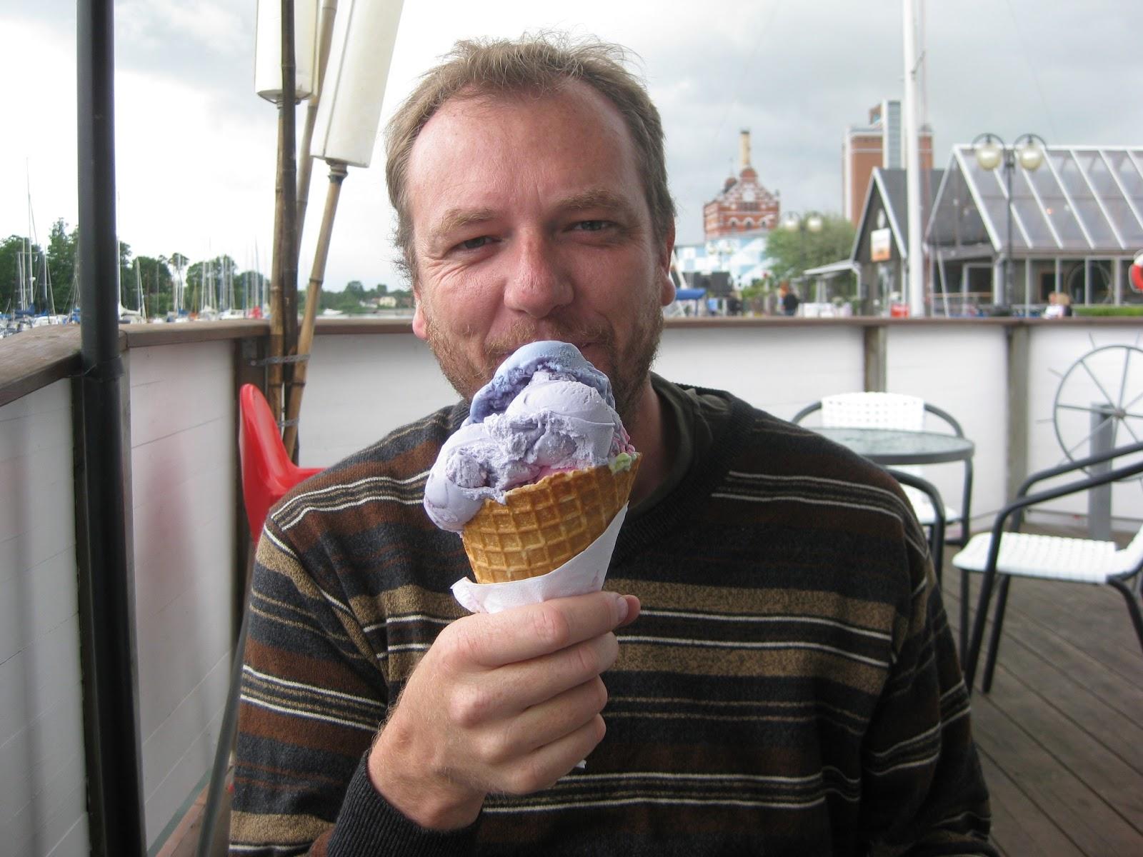 image of man eating ice cream cone