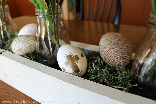 Moss forms nests for decorative eggs in this Rustic Springtime Centerpiece.