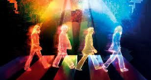 Imagem cheia de luzes equivalentes a épica cena dos Beatles na faixa de pedestres.