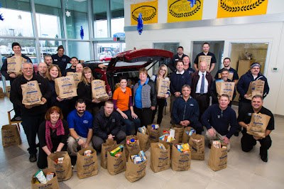 Fill-A-Bag Food Drive for SnowCap Community Charities supported by the Gresham Ford Staff