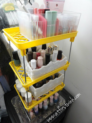 nail polishes and cosmetics tower