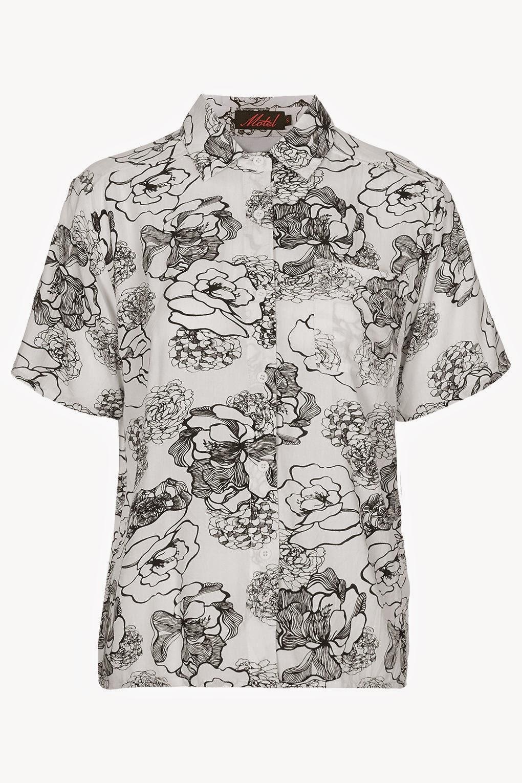 white and black print short sleeved shirt