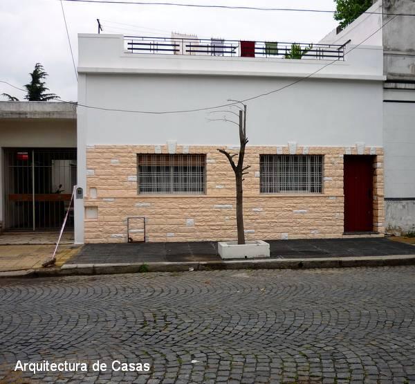 Arquitectura de casas pintura de fachada en casa de barrio for Fachadas de casas de barrio