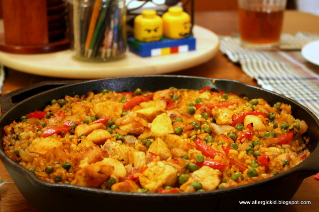 Chicken Paella, a very yellow chicken and rice dish.