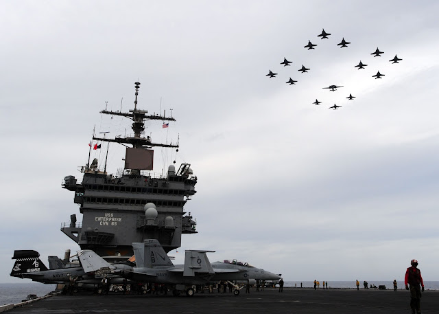 Aircraft assigned to Carrier Air Wing (CVW) 1 fly in formation over the aircraft carrier USS Enterprise (CVN 65)