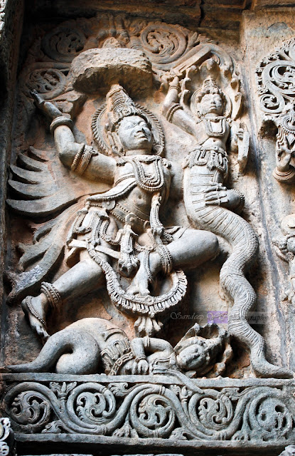 Garuda fighting with snake