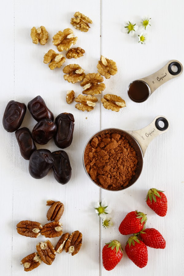 Nuts, fruits and cacao on a white background