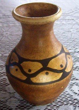 Pátina etnica con betún de Judea sobre terracota