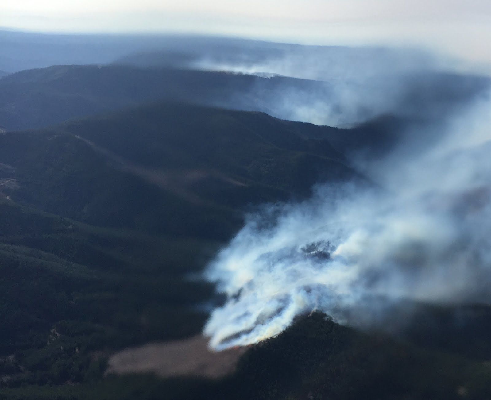 Wind rekindles slash burn fires in north Cascade foothills