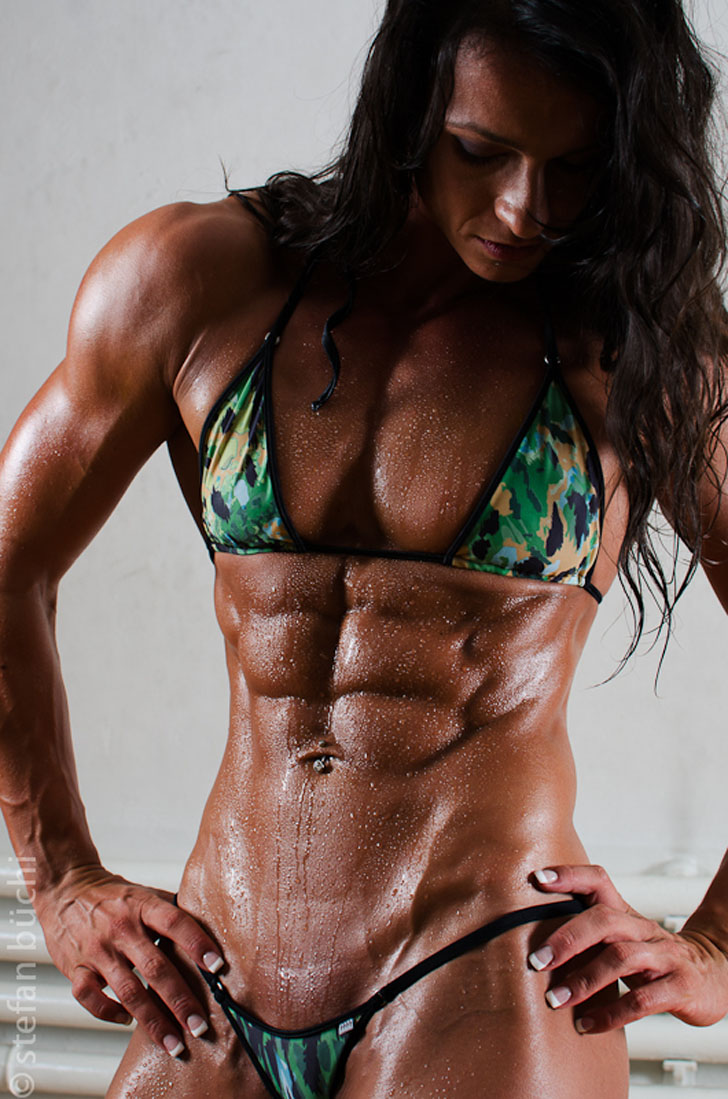 Cindy Landolt Flexes Her Ripped Abs And Chest in A Green Bikini
