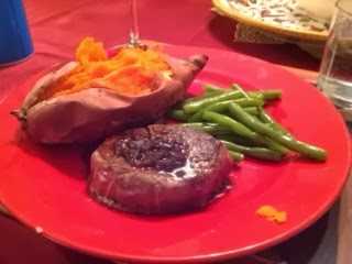 filet mignon served with sweet potato and green beans