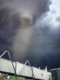 A weak tornado over Denver International Airport [Photo: Mike Sellers]