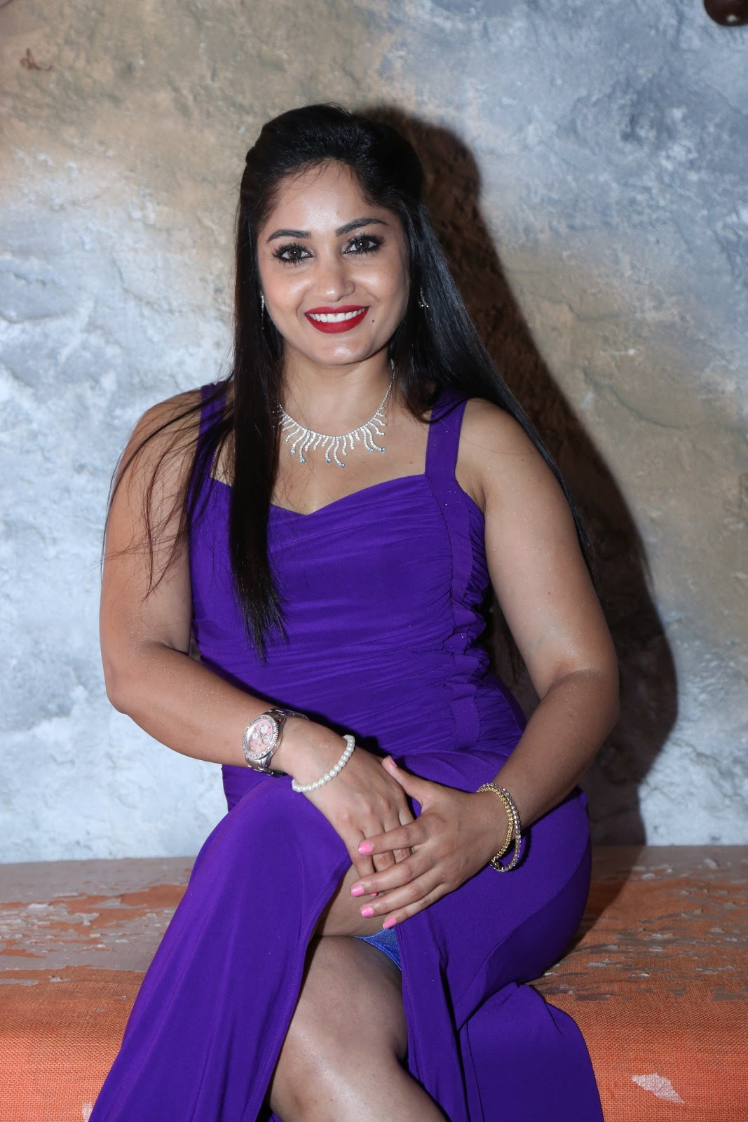 Madhavi Latha in Spicy Sleeveless Purple Leg Split Gown Spicy Pics