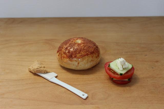 Challah Bagel, Asiago Cheese, Hummus, Tomato, Cucumber, and Feta