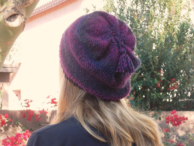 It's giveaway time and this month I have a pretty, pink and purple, hand knit beanie to keep you cozy!