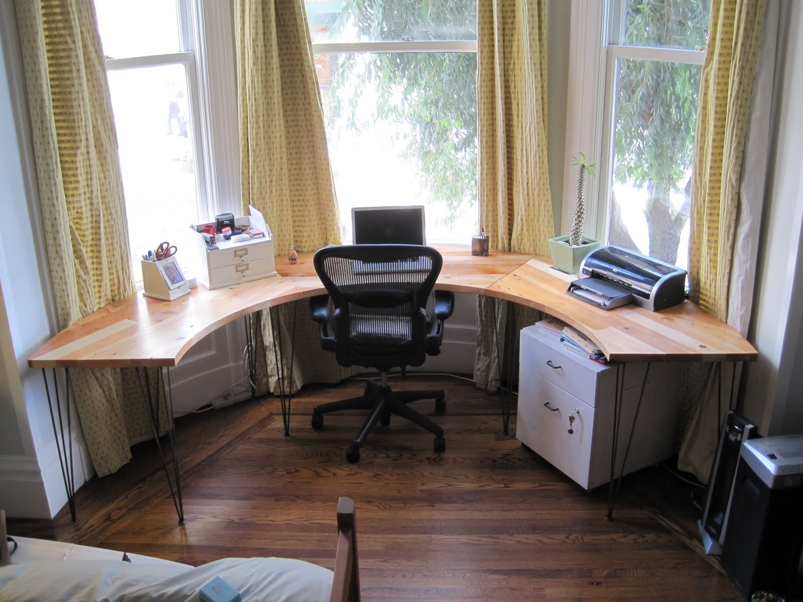 As the saw blade turns bay window desk for The home office