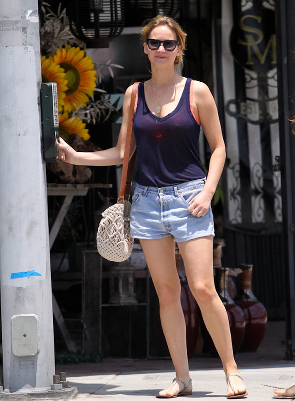 Jennifer Lawrence in denim shorts and a blue tank