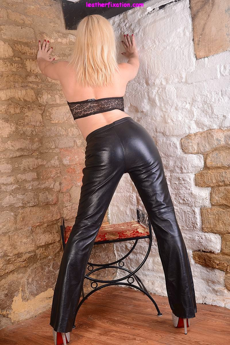 Sexy Black Leather Clings to her Ass and Those Long Legs