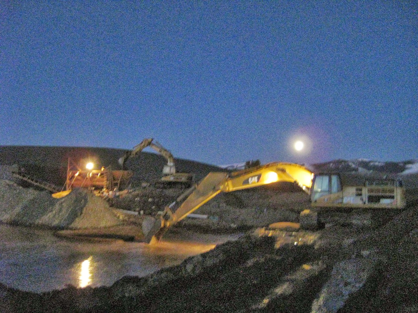 Gold mining under and October moon in Montana