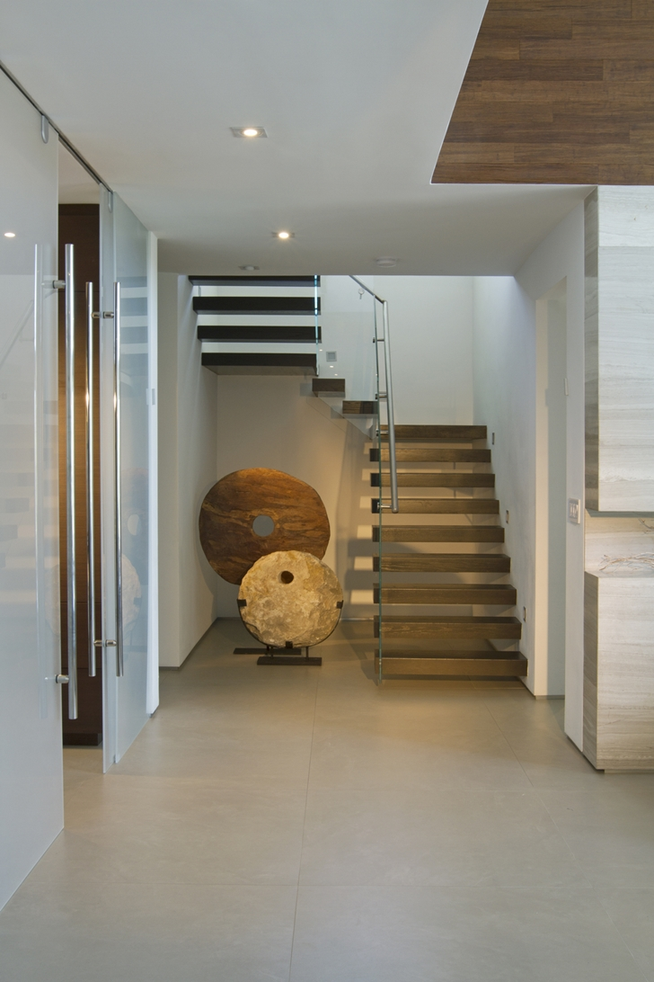 Stairs in Modern home by DKOR Interiors