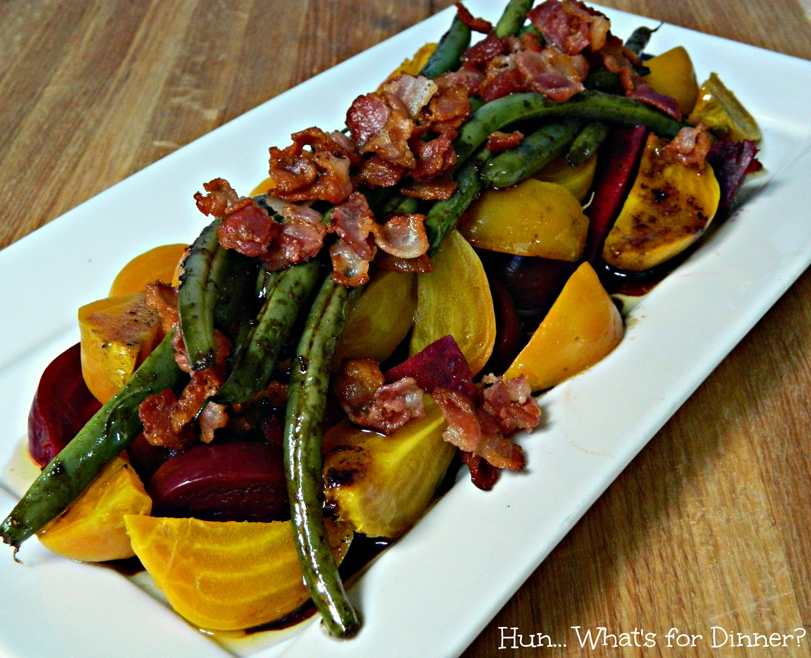 Tender beets are topped with warm green beans, bacon and a delightful warm vinaigrette.