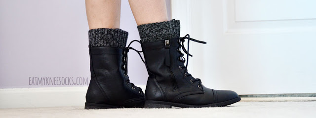 AMIClubwear's lace-up mid-calf combat boots are perfect for any outfit, with a cute heathered/marbled gray knit trim at the top and side zipper.