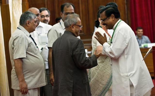 Presidential Candidate Sh. Pranab Mukherjee being greeted by Sh. Satya Pal Jain, Polling Agent of Presidential Candidate Sh. P. A. Sangma, at Parliament House during Presidential Election 2012. | AFP/GettyImages/Prakash Singh