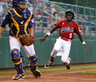Lugazi Uganda Little League in action playing baseball